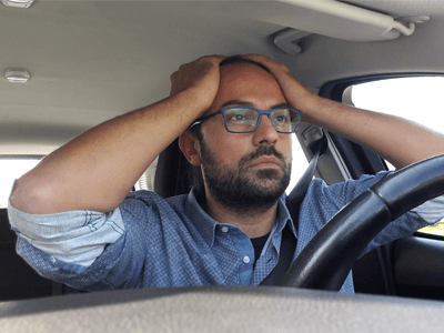 Fear of learning to drive - student tense at the driver seat