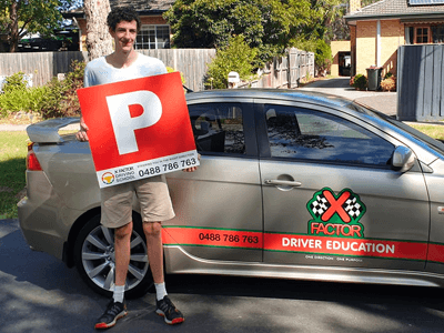 Driving test tips for learners - learner student with p plater sign after passing VicRoads driving test